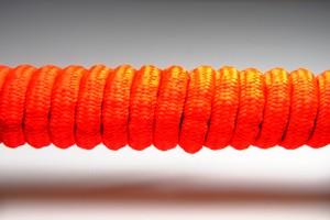Tkanička Spirálka 110cm reflexní červená